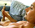 Two naked sweet dude jerk off juicy cocks on the sofa