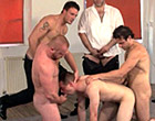 Horny men push his mouth down on each cock in turn