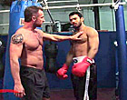 A muscular boxer screws his hairy sparring partner