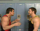 Two older jocks are fighting in the locker room